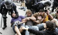 Riot police have clashed with protesters in Spain, Italy and Portugal