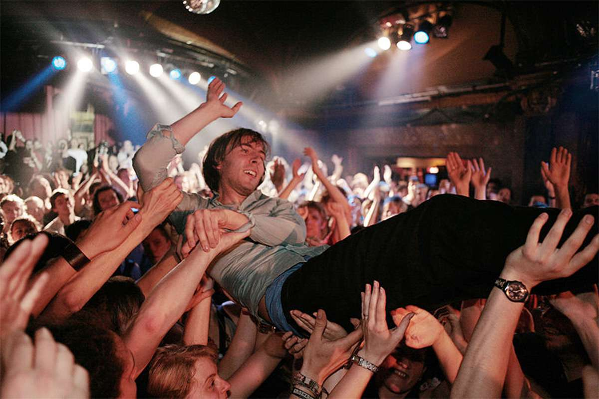 Crowd surfing at a concert (France, 2018)